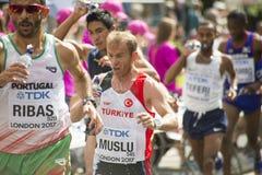 6 Aug `17 - London World Athletics Championships marathon: Portuguese athlete Ricardo RIBAS and Turkey`s Urcan MUSLU pass water Royalty Free Stock Image