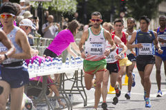 6 Aug `17 - London World Athletics Championships marathon: Portuguese athlete Ricardo RIBAS and Turkey`s Urcan MUSLU pass water Royalty Free Stock Photo