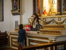 A person praying in the St. Paul Metropolitan Cathedra, Vigan City, Philippines, Aug 24,2018. Aug 24,2018 Vigan City, Philippines - A person praying in the St stock images