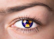 Auge mit Strahlungssymbol. Stockbilder