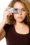 Auge am Telefon Stockbilder