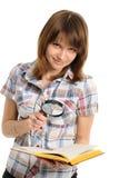Auge und Vergrößerungsglas und Buch Lizenzfreie Stockfotografie