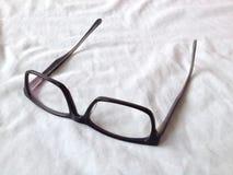 Augeengläser auf Weiß Stockfotos