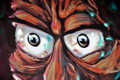 Augen auf der Backsteinmauer Stockfoto