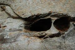 Augen des Felsenmannes Stockfotos