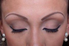 Augenbrauen-Tätowierungen Stockbild