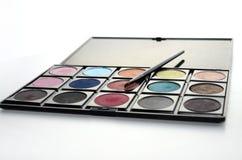 Augenschminke und Pinsel lizenzfreies stockbild
