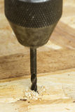 Auger bit drilling wood Stock Photos