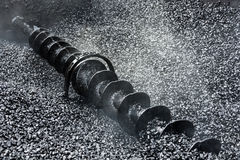Auger for mixing and supply of asphalt. Royalty Free Stock Photography