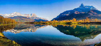 Augille de Varan Summit and Aravis Range, France. Panoramic view of Augille de Varan summit and Aravis mountain range and its reflection on the surface of Lac du Stock Photography