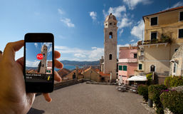 Augmented reality. A tourist consulting his phone with an application of augmented reality royalty free stock photography