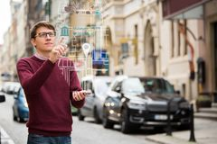 Augmented reality in marketing. Man with phone. Navigation on the projection of the display stock photos