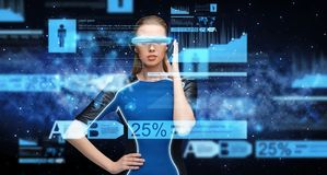 Woman in virtual reality 3d glasses with charts Stock Photography