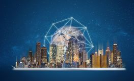 Augmented reality, smart technology and smart city technology. Digital tablet with building hologram and global network connection royalty free stock images
