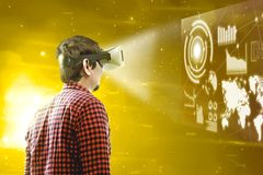 Augmented reality technology. Rear view of asian man looking at digital interface with virtual reality device display the world map, graphic bar and binary code stock photos