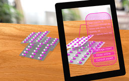 Augmented reality vitamin pills seen through a tablet. With analysis and options 3D illustration Royalty Free Stock Images