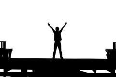 Augmenter d'homme sa main en noir et blanc Photographie stock