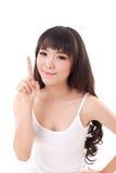 Augmenter heureux et souriant de femme, dirigeant son doigt  images stock