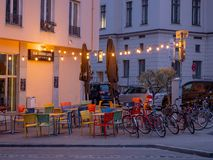 Augsburg, Germany - May 5, 2019: Outdoor arragement with colorful chairs, tables and lights from the bar Beim Weissen stock images