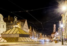 Illuminated historic foungtain in Augsburg at night Royalty Free Stock Image
