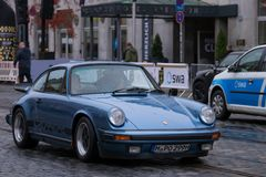 Porsche 911 oldtimer car. Augsburg, Germany - October 1, 2017: Porsche 911 oldtimer car at the Fuggerstadt Classic 2017 Oldtimer Rallye on October 1, 2017 in Stock Photos