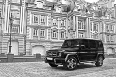 Kiev, Ukraine. August 28, 2017. Brutal off-road car on a background of beautiful buildings. Mercedes-Benz G55 AMG royalty free stock images
