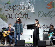 23 August 2015, Bucharest, Romania: indie band Changing Skins plays open air gig. Romanian indie band Changing Skins play an acoustic set at Copacul cu carti ( royalty free stock photography