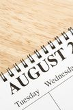 August on calendar. Close up of spiral bound calendar displaying month of August Stock Image