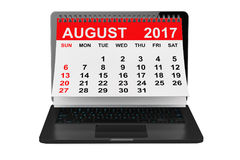 August 2017 calendar over laptop screen. 3d rendering. 2017 year calendar. August calendar over laptop screen on a white background. 3d rendering Stock Photography