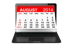 August calendar over laptop screen. 2014 year calendar. August calendar over laptop screen on a white background Stock Photo