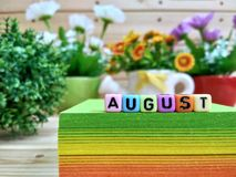 August. Colorful cube letters on sticky note block. stock photos