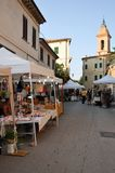 Street market in the medieval village of Staffolo in Italy. 19 August 2018, Event: stands of various vendors in the Wine Festival in the medieval village of royalty free stock photography