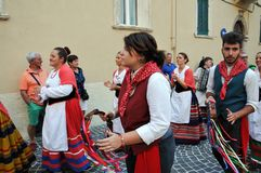 Wine festival in the medieval village of Staffolo in central Ita. 19 August 2018, Event Wine festival: musicians and people with traditional clothes in the stock image