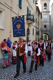 Wine festival in the medieval village of Staffolo in central Ita. 19 August 2018, Event Wine festival: musicians and people with traditional clothes in the stock images