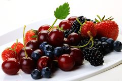 August fruits on a white background. Fruits of August, berries juicy strawberries and other healthy fruits Stock Photos