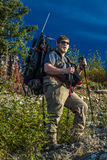 August 27, 2016 - Hunter backpacks into wilderness with supplies and gun, Denali State Park, Alaska Stock Photo