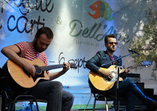 23 August 2015: indie band Changing Skins plays Cismigiu. Romanian indie band Changing Skins plays an acoustic set at Copacul cu car?i Book Tree) festival in royalty free stock photography