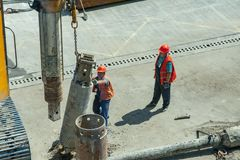 Builders while working. August 17, 2017. Kyiv, Ukraine. Boryspil international airport. Builders construct a part of the airport terminal royalty free stock images