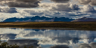 AUGUST 26, 2016 - Lakes of Central Alaskan Range - Route 8, Denali Highway, Alaska,a dirt road offers stunning views of Mnt. Hess. Mountain, & Mt. Hayes and Mnt Stock Photo