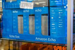 August 2, 2018 Los Altos / CA / USA - Amazon Echo boxes inside a glass display located in one of the Whole Foods stores in San royalty free stock image