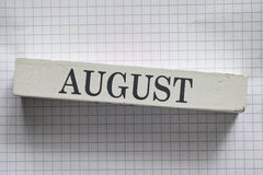 August. Month printed on wooden block royalty free stock photography