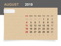 August 2019 - Monthly calendar on brown paper and wood background with area for note. Vector illustration royalty free illustration