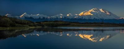 AUGUST 28, 2016 - Mount Denali at Wonder Lake, previously known as Mount McKinley, the highest mountain peak in North America, at  Stock Photos