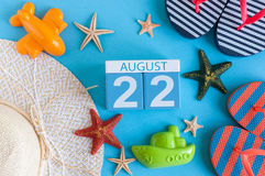 August 22nd. Image of August 22 calendar with summer beach accessories and traveler outfit on background. Summer day Royalty Free Stock Photos