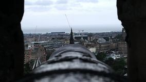Panorama from a cannon. August 2017: Panorama of the city from the point of view of a cannon on the castle. You notice the Ferris wheel, some cranes and the sea stock footage