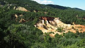 Panorama of Colorado of Provence in 4k. August 2018: Panoramic view of the ocher quarries at Rustrel, the day is sunny and windy. Ideal for the park trekking stock video