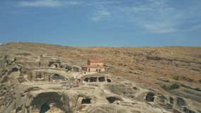 10 August, 2017 - Uplistsikhe, an ancient rock-hewn town near Gori in Georgia. 10 August, 2017 - Panoramic view of Uplistsikhe, an ancient rock-hewn town near stock video