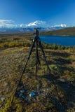 AUGUST 28, 2016 - Photographer Joe Sohm poses at famous Ansel Adams picture spot, Wonder Lake, Mount Denali, Kantishna, Alaska Stock Image