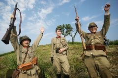 Japanese soldiers-reenactors reproduce the attack on the Soviet army during the Second World War. August 10, 2013, Primorsky Krai - Japanese soldiers-reenactors stock photography