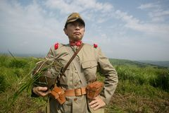 Japanese soldiers-reenactors reproduce the attack on the Soviet army during the Second World War. August 10, 2013, Primorsky Krai - Japanese soldiers-reenactors royalty free stock images
